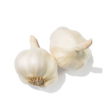 Two garlic heads isolated on white background, top view.