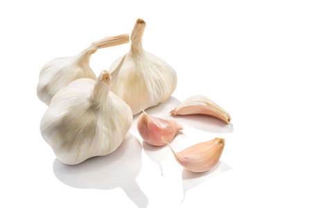 Garlic heads and cloves isolated on white background.