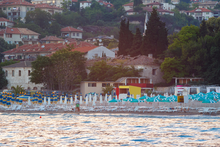 balchik: View of the beach and Balchik city on black sea coast in Bulgaria in sunset time. Stock Photo