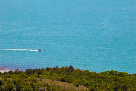 Sea view from altitude on the hill, boats in azure water at the sunny summer day.
