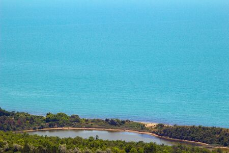 Sea view from altitude on the hill, azure water at the sunny summer day.