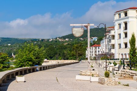 Balchik cityscape, view of city quay with apartment buildings and houses on the hills of black sea coast in Bulgaria. Stock Photo