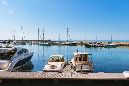 Yachts, sailing boats and pleasure boats are moored in marina of Balchik city in black sea coast at Bulgaria.
