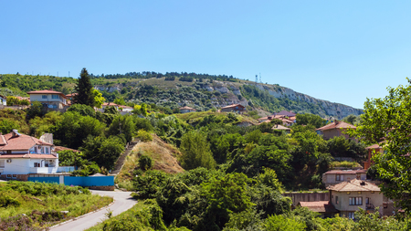 balchik: Cityscape of balchik town, houses on green hill, black sea coast in Bulgaria. Stock Photo