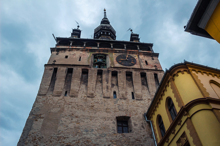 Ancient and medieval clock tower in Sighisoara town at Romania.