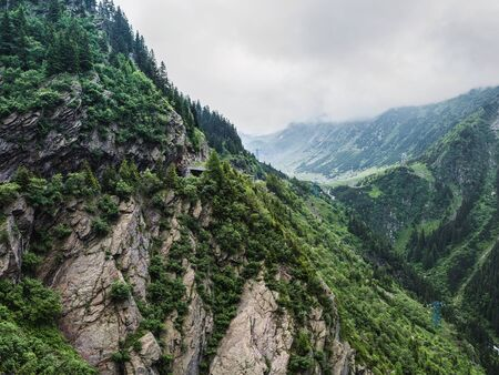 Carpathians nature landscape of rocky Fagaras mountains in cloudy weather at Romania, spectacular wilderness scenery. Stock Photo