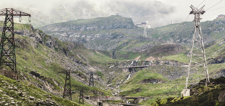 Panoramic view of the Fagaras mountains with famous and dangerous Transfagarasan road in Carpathians, Romania, spectacular wilderness scenery. Stock Photo