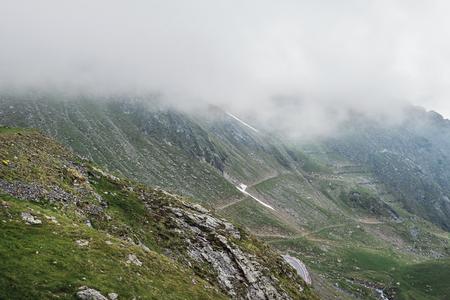 Mountain landscape of the high rocky Fagaras mountains in Carpathians, near the Transfagarasan road, Romania. Stock Photo