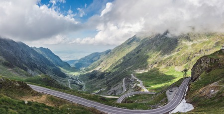 Panoramic view of the most famous and dangerous road in Europe is a Transfagarasan road in Carpathian mountains, Romania.