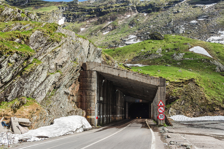 Famous Transfagarasan road with tunnel in Carpathian mountains, Romania.