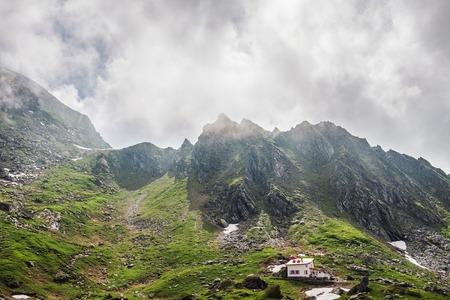 Mountain landscape of the high rocky Fagaras mountains in Carpathians, near the Transfagarasan road and balea lake, Romania.