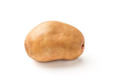 Uncooked, unpeeled, fresh whole one potato isolated on white background.