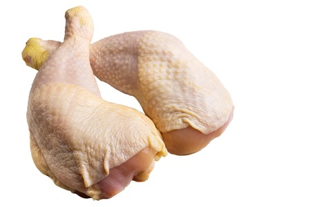 Two fresh, raw chicken legs or thighs isolated on white background. Stock Photo