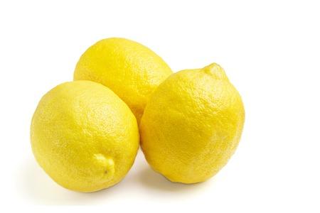 Three yellow ripe lemon fruit, isolated on a white background. Stock Photo