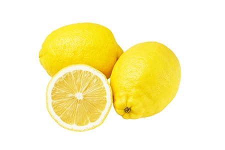 Two whole yellow ripe lemon fruit and one round slice, isolated on a white background, top view.