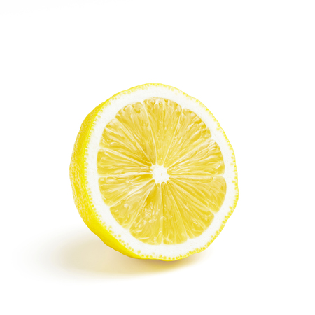 Half of yellow ripe lemon fruit, isolated on a white background.