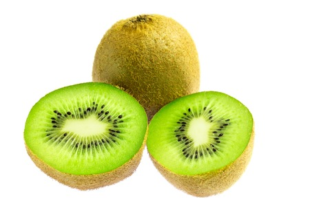 One whole kiwi fruit and two halves isolated on white background. Stock Photo
