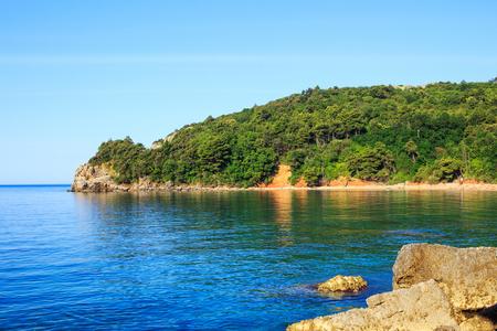 Adriatic sea coastline and Mogren beach at Montenegro, mediterranean summer seascape, nature landscape, vacations in the summer paradise.