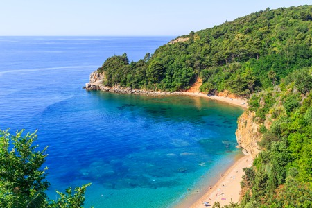 View from above on Adriatic sea coastline and Mogren beach at Montenegro, nature landscape, vacations to the summer paradise.