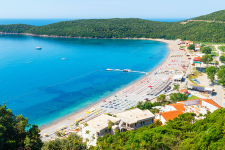 View from above on Adriatic sea coastline and Jaz beach at Montenegro, nature landscape, vacations to the summer paradise.