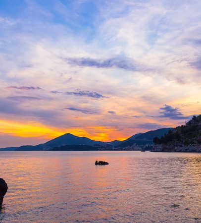 Awesome colorful sunset on the Adriatic sea coastline in Montenegro, gorgeous seascape.