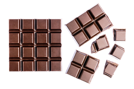 Chocolate cubes, pieces of bitter, dark chocolate bar, isolated on white background, top view. Archivio Fotografico