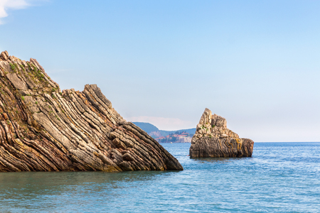 Rocks in the water of Adriatic sea in Montenegro, gorgeous summer seascape.