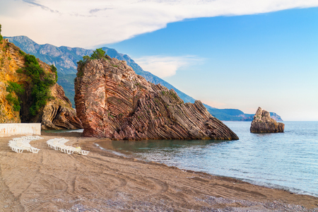 Adriatic sea coastline near Budva city in Montenegro, gorgeous seascape with big rock on the beach.