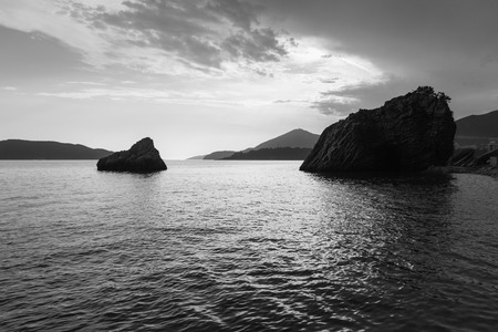 Adriatic sea with rocks in the water at Montenegro, black and white. Stock Photo