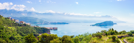 View from above to the Adriatic sea coastline and Budva city surrounded by mountains, Montenegro, panoramic view. Stock Photo