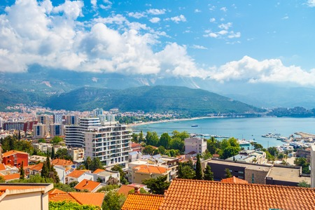 Cityscape of Budva city surrounded by mountains on Adriatic sea coastline at Montenegro. view from above. Stock Photo