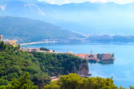 View from above to the Adriatic sea coastline and Budva city surrounded by mountains, Montenegro.