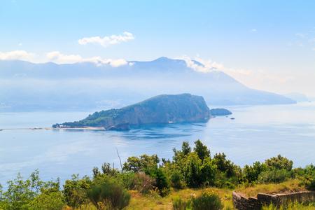 View from above on Adriatic sea coastline and Sveti Nikola island near Budva city at Montenegro, nature landscape, vacations to the summer paradise. 스톡 콘텐츠