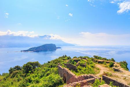 View from above on Adriatic sea coastline and Sveti Nikola island near Budva city at Montenegro, nature landscape, vacations to the summer paradise. Stock Photo