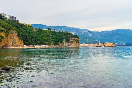 View to the Adriatic sea coastline, old city Budva and Mogren beach in Montenegro, nature landscape.