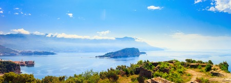 View from above to the Adriatic sea coastline and Budva city surrounded by mountains, Montenegro, panoramic view. 스톡 콘텐츠