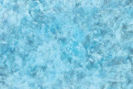 Abstract blue paint on a surface, texture art background. 免版税图像