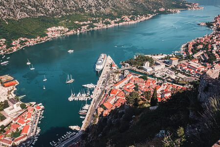 Boka Kotor bay and medieval town Kotor on Adriatic sea coast at Montenegro. View from above.