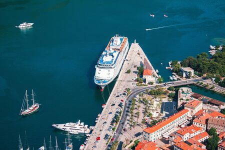 Big cruise Liner in the harbor of medieval town Kotor on Adriatic sea coast at Montenegro. View from above. Stockfoto