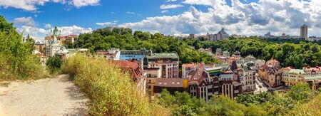 Panorama of historical part of Kyiv city with Andriivska church on Andriyivskyy descent, Vozdvyzhenka with ancient colorful buildings, Ukraine.