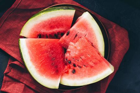 Pieces of fresh watermelon in the plate, top view. Stockfoto