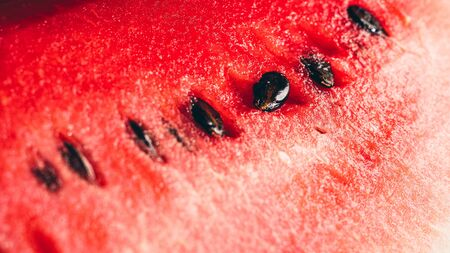 Red watermelon with seeds close-up view, selective focus. Stockfoto