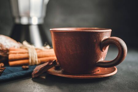 Brown cup with hot drink, coffee, tea or chocolate on dark background. Stock fotó