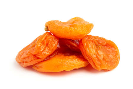 Dried apricots fruit, isolated on white background, close up view. 免版税图像