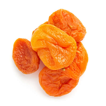 Dried apricots fruit, isolated on white background, close up, top view.