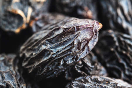 Dark blue raisins extreme close-up view.