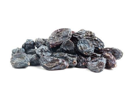 Dark blue raisins isolated on white background.