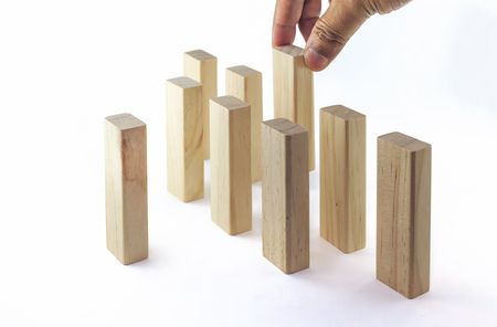 Leadership, Business concept growth success process. The hand establishes a group in row. It is isolated on a white background