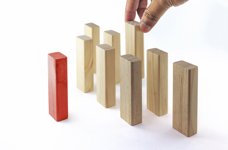 Leadership, Business concept growth success process. The hand establishes a group in row. Red color (manager) stand out from the crowd