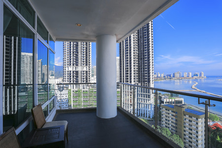 Condominium balcony with sea view from skyscraper building - Penang, Malaysia